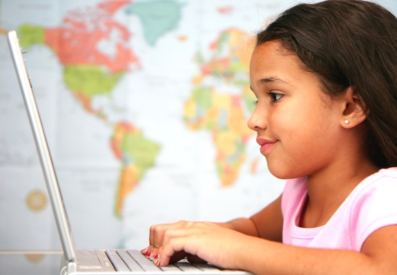 A Young Girl using a Computer